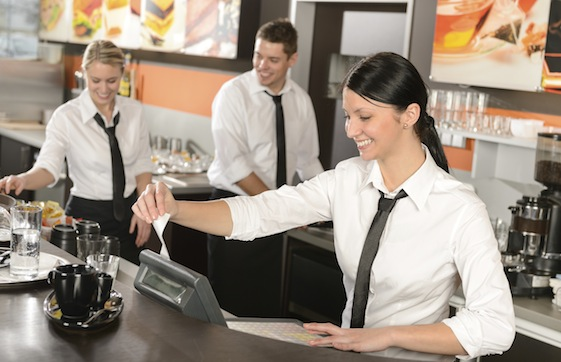 Female cashier giving receipt working in cafe